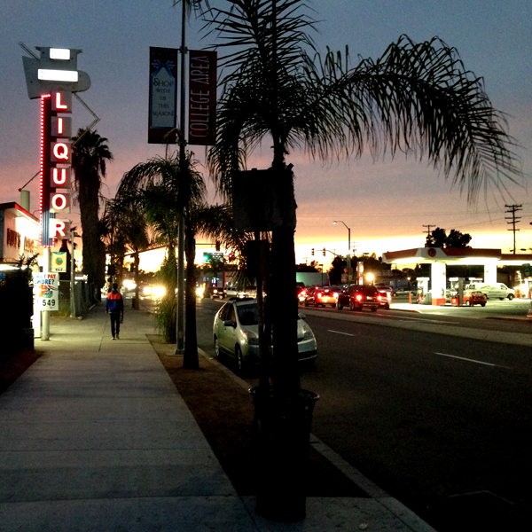 Sunset lights and lonely figures on El Cajon Blvd.