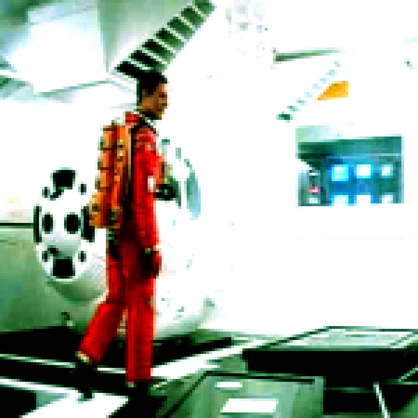 Bowman enters the space capsule