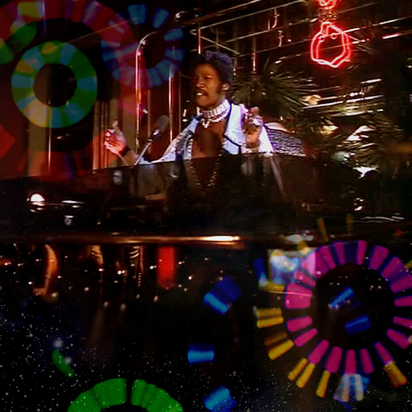 Rudy Ray Moore IS Disco Godfather, spinning in the club amidst a psychedelic kaleidoscope of sound