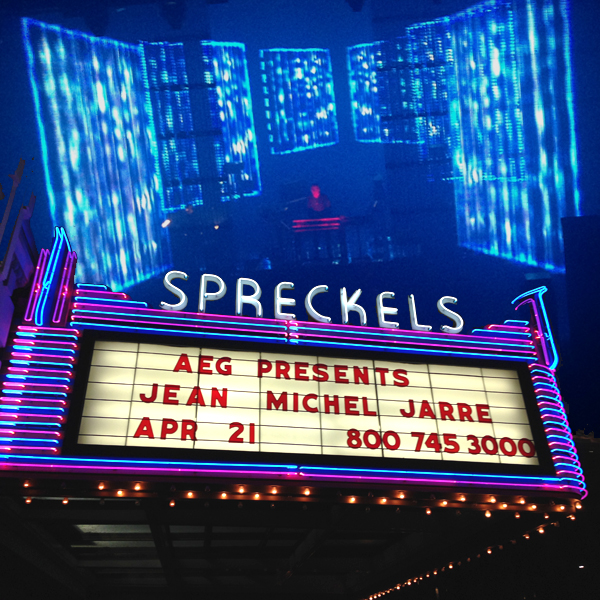 Jarre performs live as the Spreckels marquee looms in the foreground