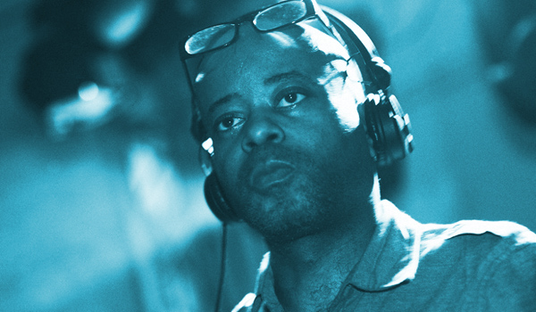 Juan Atkins, wearing headphones, looks on