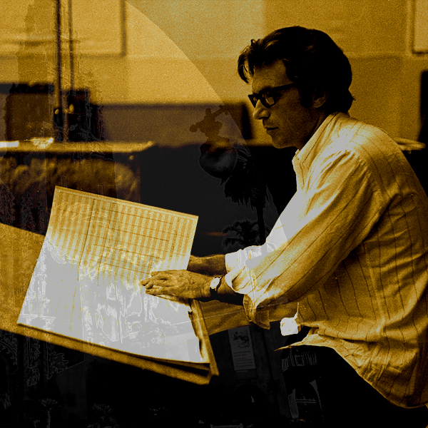 A young David Axelrod in glasses and a button shirt studies his musical notation