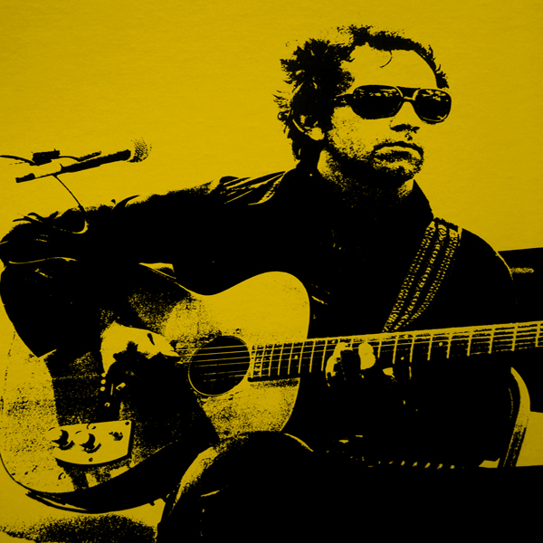 J.J. Cale strums his guitar in shades