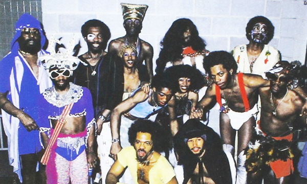 Funkadelic pose for a picture in trademark outlandish attire