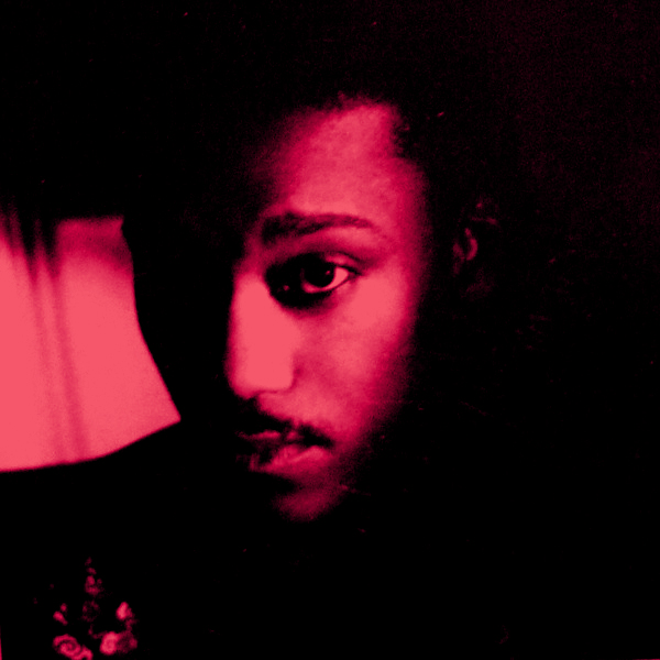 Jellybean Johnson, the drummer from The Time, under hot pink lights