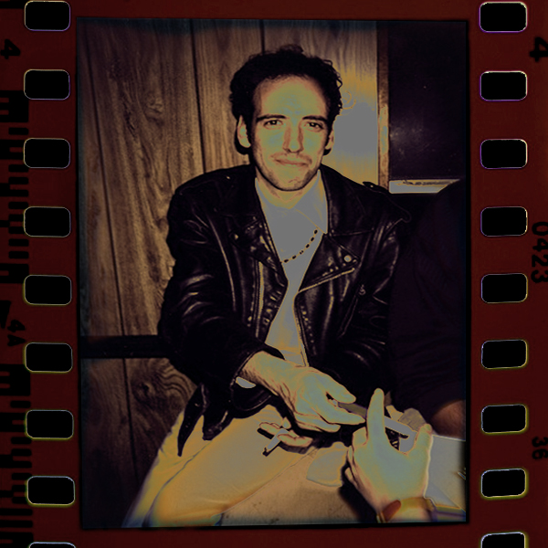 Mick Jones in a film strip, chillin' out in a leather jacket