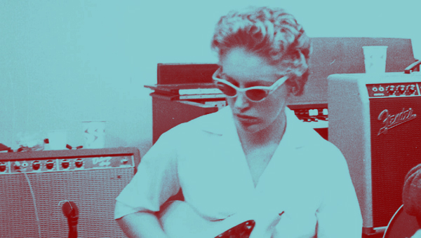 Carol Kaye with trademark shades and guitar