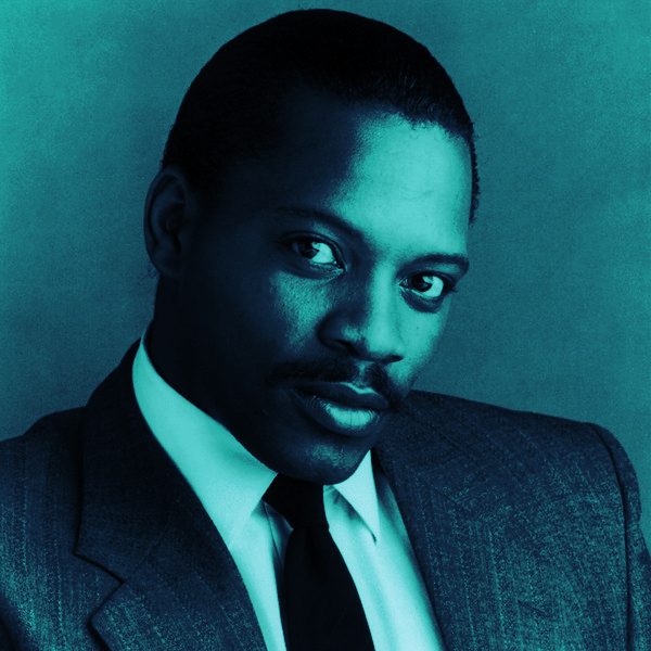 Alexander O'Neal looking dapper in a suit in shades of deep blue