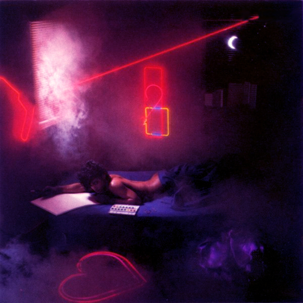 Prince painting in his bedroom under neon lights