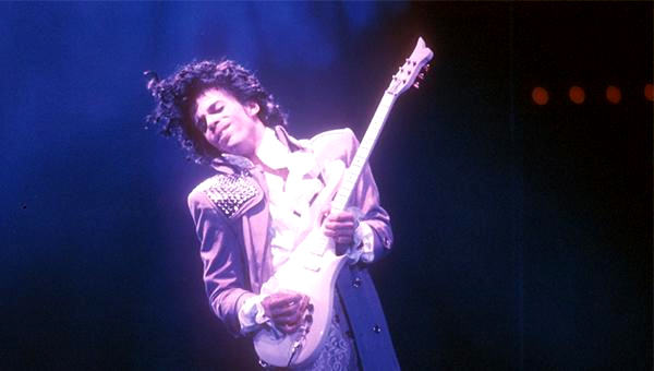 Prince play a trademark guitar solo