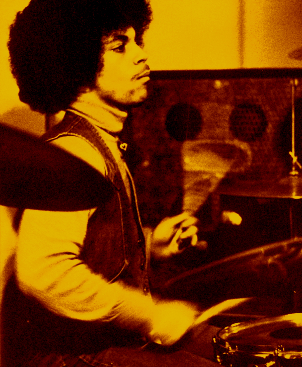A young Prince plays the drums