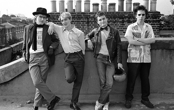 Public Image Ltd. pose on a rooftop