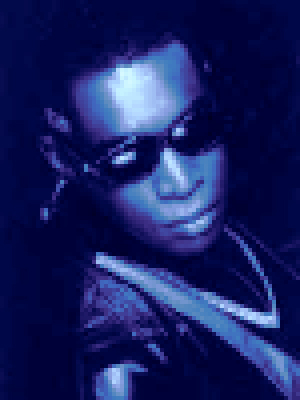 A pixelated image of Kevin Saunderson in shades, looking like something from a contemporary video game