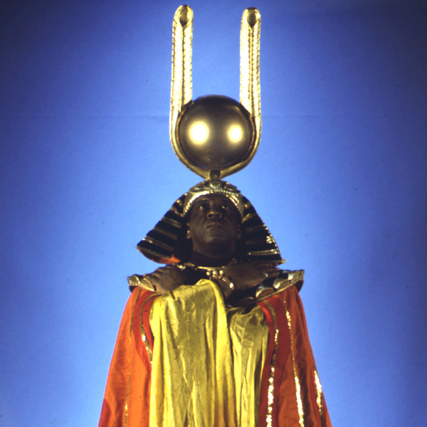 Sun Ra striking the Pharaoh's pose decked out in ceremonial garb