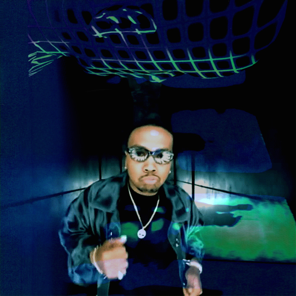 Timbaland sashays backwards in the cyberpunk hallway from The Rain music video, while the vector head from Freaky Chakra's Blacklight Fantasy looks on