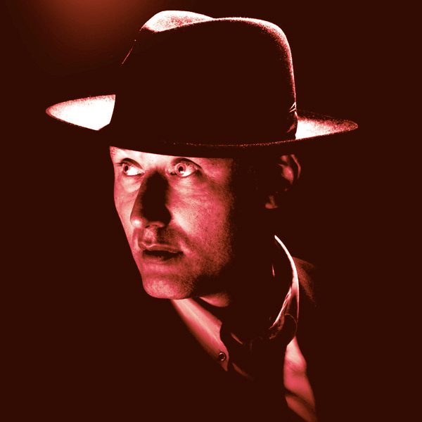 Jah Wobble looking dapper in a suit and fedora