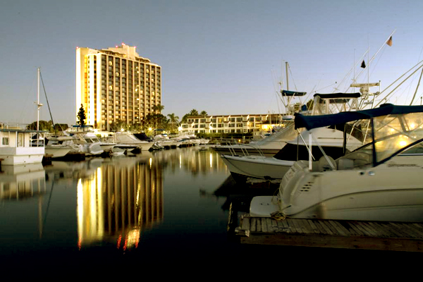 Yachts docked at the crystal clear waters of the San Diego harbor