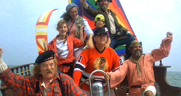 John Candy and crew on a sailboat (from the movie Summer Rental)