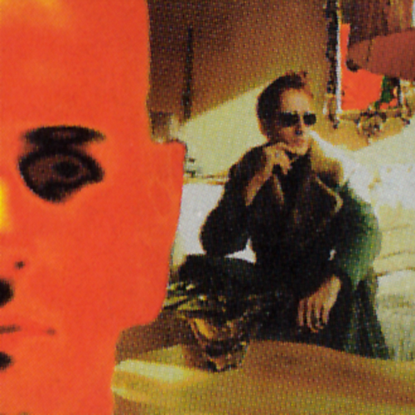 Half of Dougans' face in deep crimson; Cobain looks on in the background