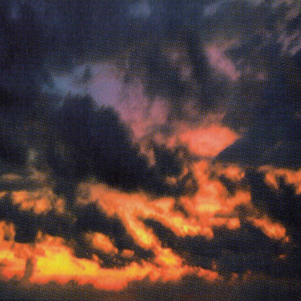Clouds at sunset in deep hues of orange and violet