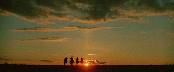 The crew rides into the sunset at the end of Indiana Jones' Last Crusade