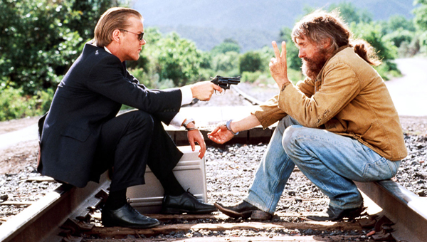 Kiefer Sutherland holds a gun on Dennis Hopper in the film Flashback