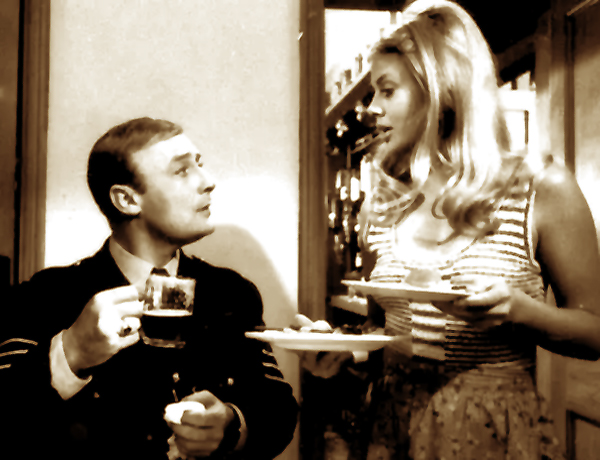 Edward Woodward and Britt Ekland converse in a Summerisle pub