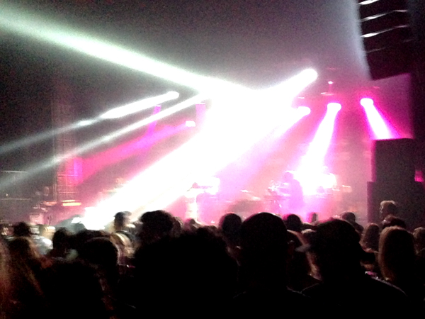 Hot Chip performs under neon lights