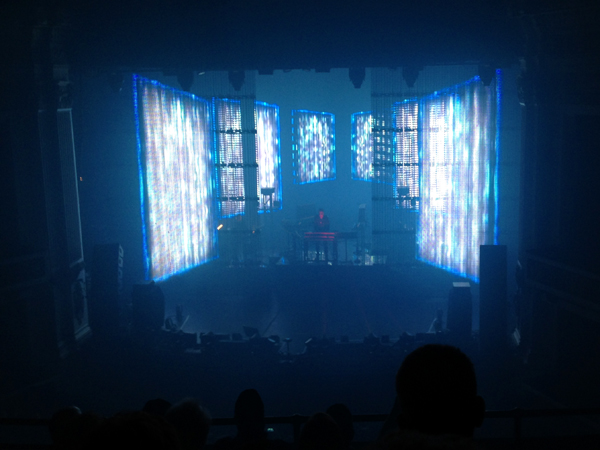 Giant video screens open like doors to reveal Jarre on stage