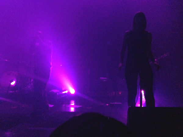 Marta standing in the mist as Tricky sings in the background (the lights in a Purple Rain)